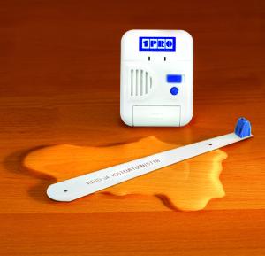 1PRO Vuoto- ja kosteushälytin kuva parketilla edestä logolla